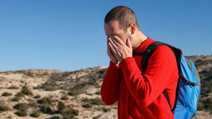 CBD for migraine man holding head