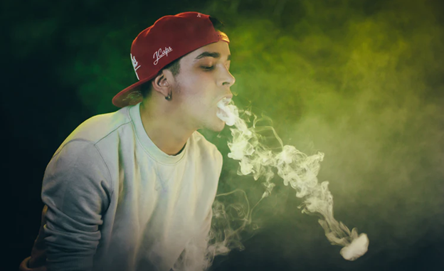 man smoking non nicotine vape