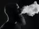 man smoking an e-liquid smoke cloud