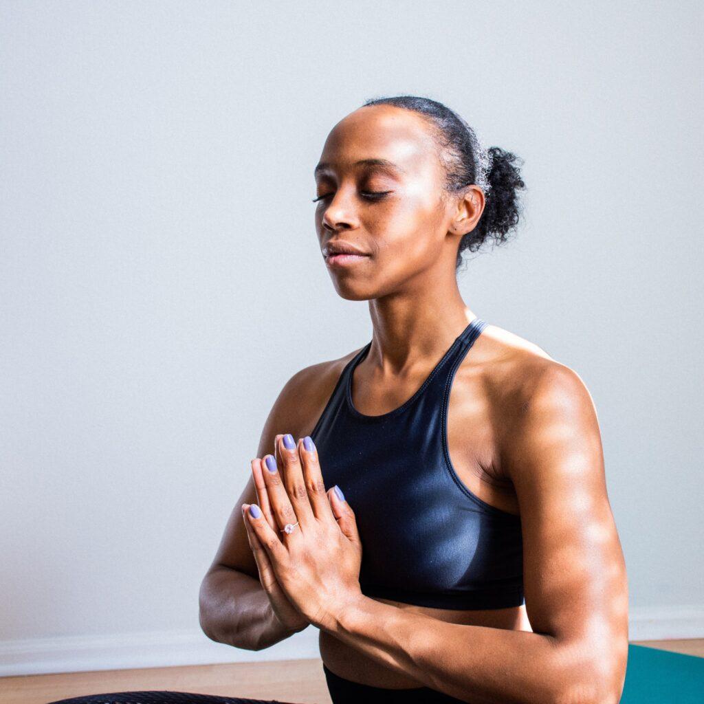 woman meditating on cannabis